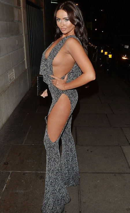 Popular Television Personality Charlotte Dawson Has Risked A Wardrobe Malfunction As She Flashes Both Her Chest And Legs In Slashed Jumpsuit For London