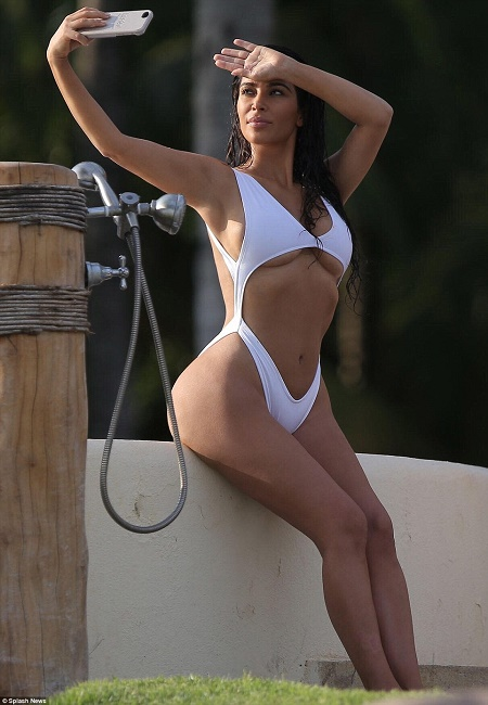 03f7770db7 The 35-year-old TV star who is enjoying vacation in Mexico paraded her  wonder body in a skimpy swimsuit showing her curves. Her impressive shape  and flat ...