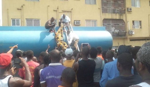 Tragedy in Delta as Security Guard Dies Naked Inside Petrol Tanker While Scooping Fuel (Photos)