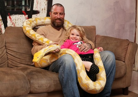 Child and Snake stock image. Image of snakes, dangerous