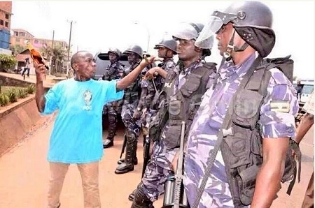 Hilarious! See What this 'Bloody Civilian' was Pictured Doing to Armed Policemen in Public (Photos)