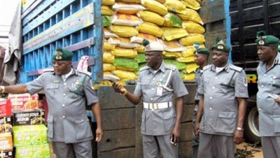 Image result for Customs warns against Importing rice through land borders