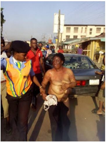 Female Child-Kidnapper Caught, Stripped And Beaten By Angry Mob In Imo (Photos)