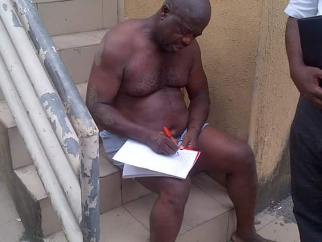 Alleged Ekiti State Politician Stripped to Boxers After He was Reportedly Caught Stealing Bottles of Drinks (Photos)