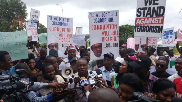 Rented Crowd? Nigerians React After Buhari Supporters Staged March in Abuja to Support His Government