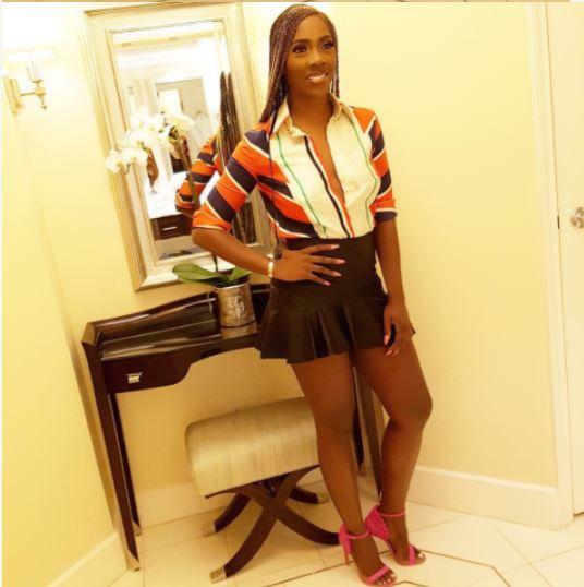 Nigerian Singer, Tiwa Savage Rocks Hot Mini Skirt With An Unbuttoned Shirt –