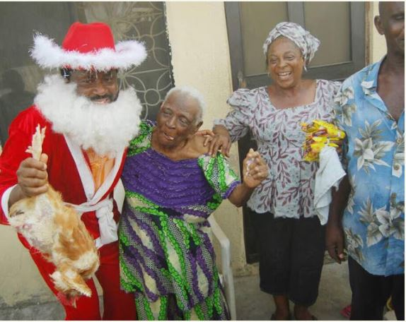 Desmond Elliot Dresses Up As Father Christmas, Visits His Constituency (Photos)