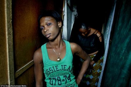 Prostitutes pose for photos inside Nigerian slum brothel