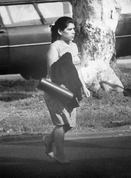 Lina as an adult in 1969 making her way into an office where she worked in Peru