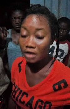 Angry Mob Almost Lynch Young Lady After Being Caught Trying to Change Fake US Dollars (Photos)
