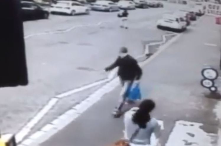 So Hilarious: Man Staring at a Woman on the Street Ends Up on the Floor... See How It Happened (Video)