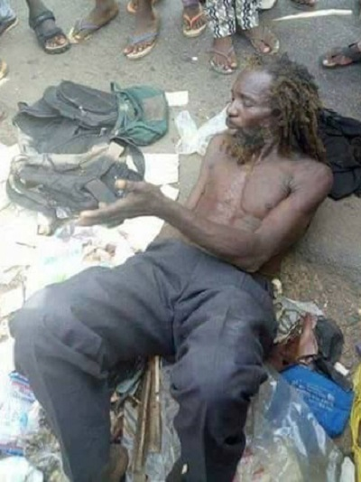 Shock as Alleged Mad Man is Caught in Asaba With Bags of Used Baby Diapers (Photos)