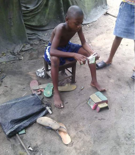boy%20keke2 - Port Harcourt Boy Constructs 'Keke Napep' with Bathroom Slippers (Photos)