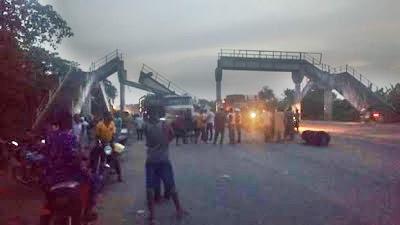 Tragedy Averted as Truck Carrying a Bulldozer Accidentally Pulls Down a Pedestrian Bridge in Osun (Photos)