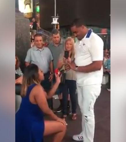 Beautiful Woman Kneels Down and Proposes to Boyfriend Before a Large Crowd (Video)