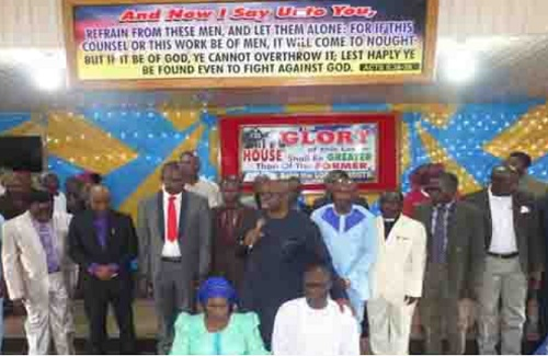 Prof. Olusola and Wife Kneel Before Gov. Fayose, Celebrate Endorsement as Ekiti PDP Guber Candidate