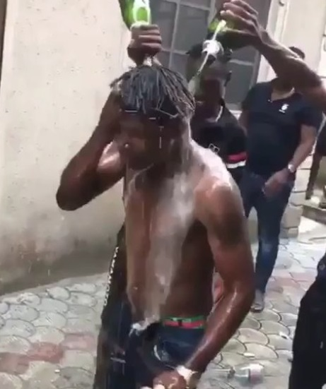 Young Men Seen Bathing In Bottles Of Champagne In Celebratory Mood (Photos)