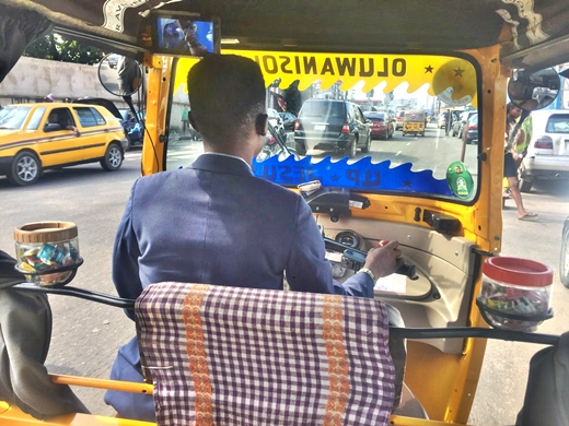 SHOCKING !!!:  Viral Photos Of A Corporate Tricyclist Who Customizes His Keke Napep With Sweets For His Passengers