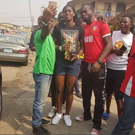 African Women's Footballer of the Year, Asisat Oshoala Celebrates Her CAF Award in the Streets of Mushin (Photos)