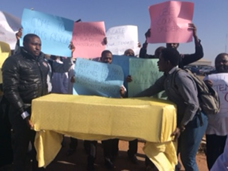 Drama As Angry Doctors Storm The Streets Carrying A Coffin In Jos As JUTH Sacks 68