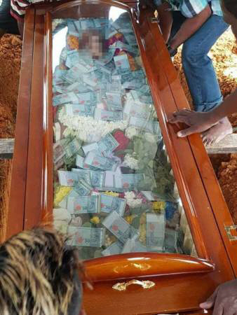 Buried In Cash: See How A Man Buried His Father In Glass-top Coffin Filled With Thousands Of Cash (Photos)