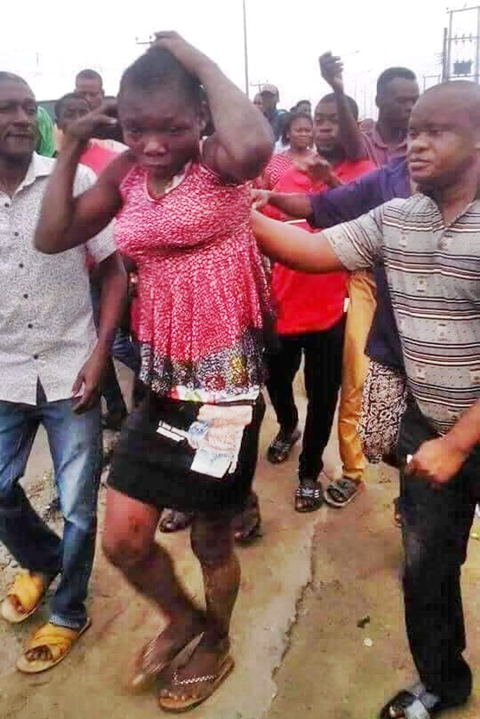 Drama As Suspected Kidnapper Disguised As A Lady Is Caught In Rivers State (Photos)