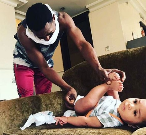 Check Out Adorable Photo Of D'banj Changing Son's Diaper