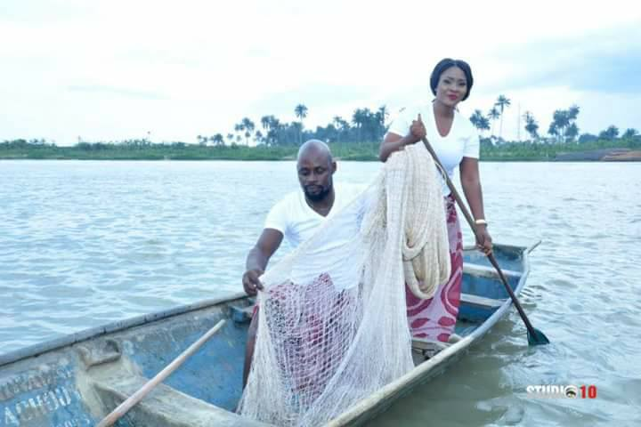 Young Ijaw Couple Spotted Fishing In A River With Net And Canoe In Beautiful Pre-Wedding Photos
