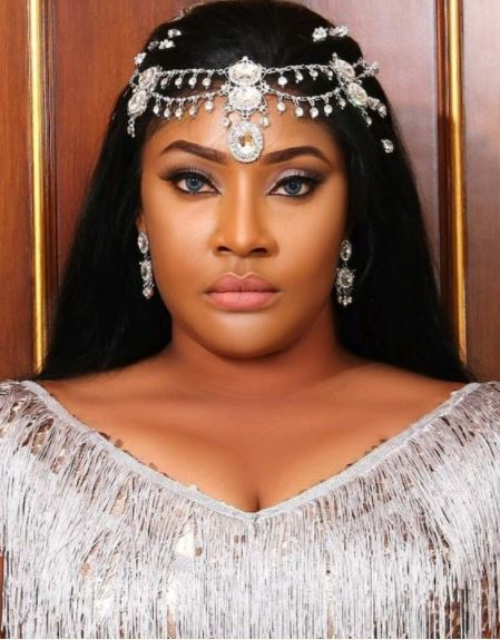Nigerian Actress Angela Okorie Fights Dirty With Fan On