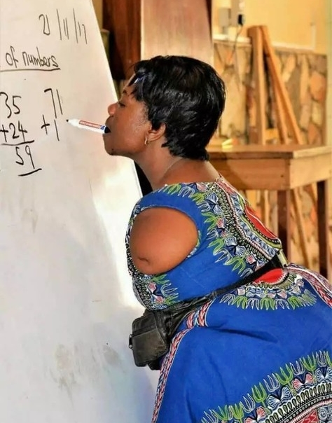 Photo Of Armless Lady Teaching Mathematics And Writing With Her Mouth Goes Viral