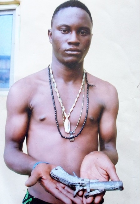 Face Of 20-Year-Old Notorious Cultist Arrested With Gun By SARS In Lagos (Photo)