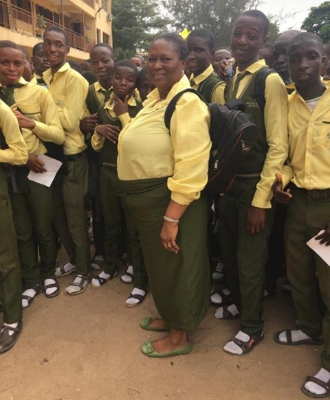 A school principal has been captured on camera in a uniform as she switches role