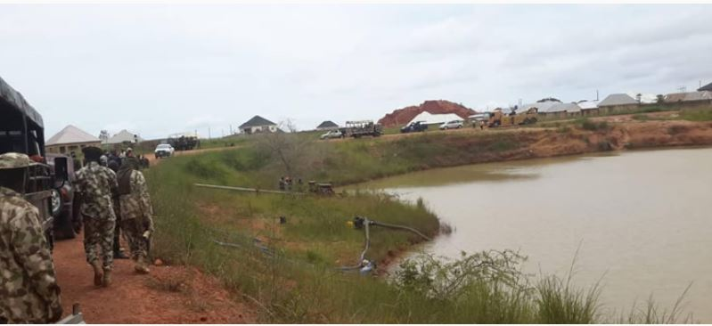 About 11 cars and two corpses have been recovered from the mystery pond in Plateau