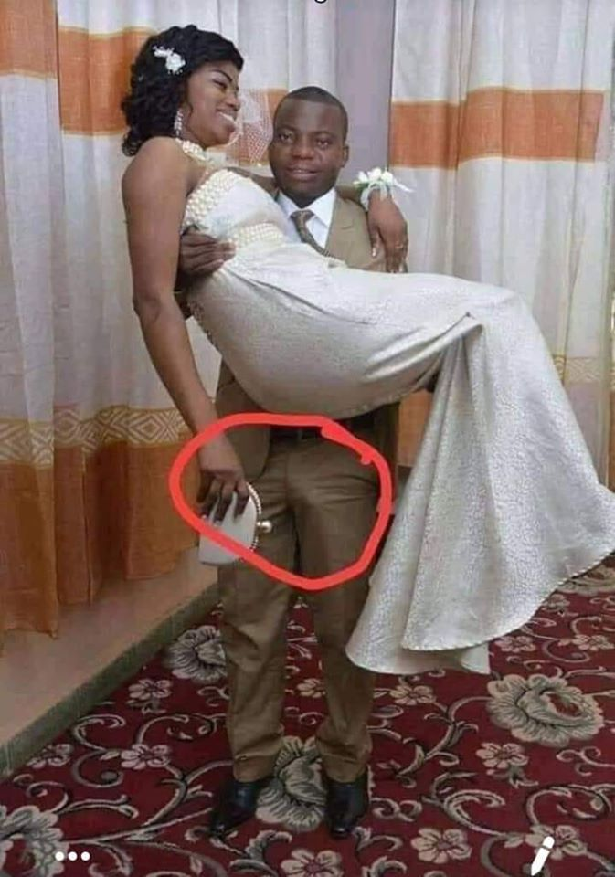 The man while lifting his wife