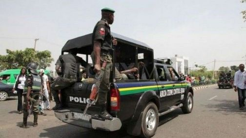 police officer surrenders