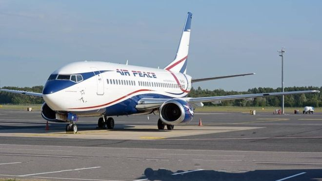 man smokes on Air Peace