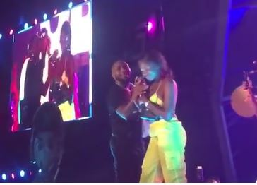 Davido gifts fan money on stage