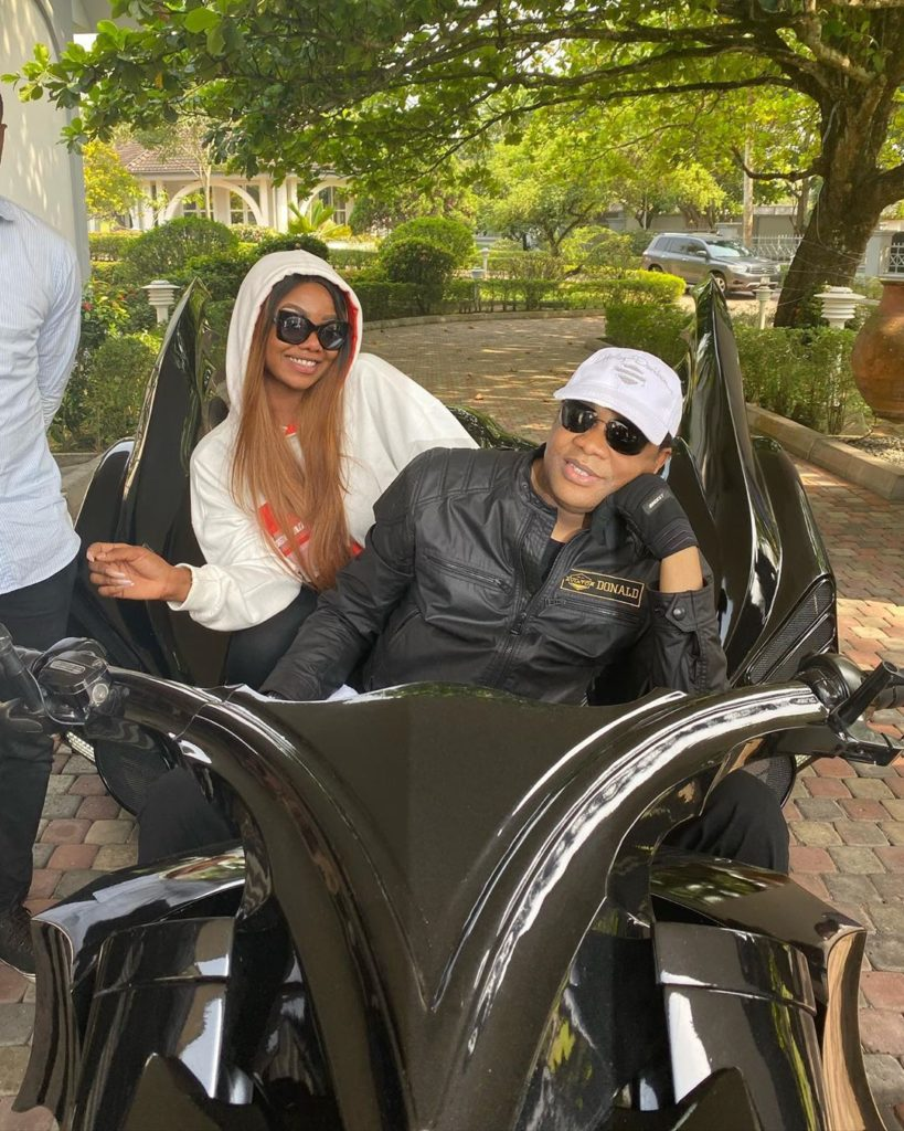 Tacha cruising on powerbike with Donald Duke