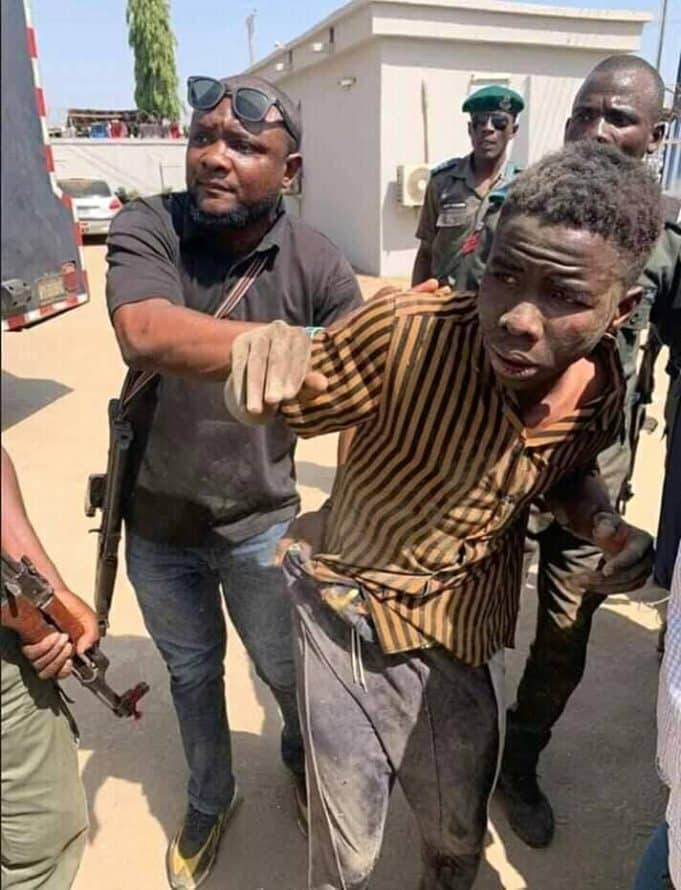One of the armed robbers arrested in Abuja during the robbery