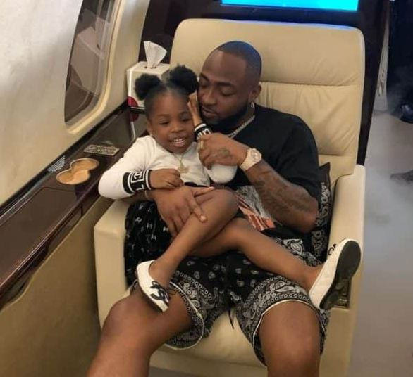Davido plays with daughter, Imade inside private jet