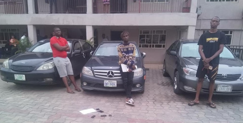 17 Suspected Yahoo Boys Pose In Front Of Their Expensive Cars After Being Arrested In Delta (Photos)