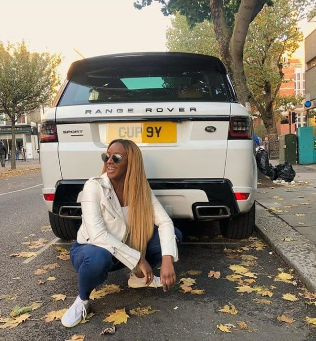 DJ Cuppy Poses With Her Range Rover Car