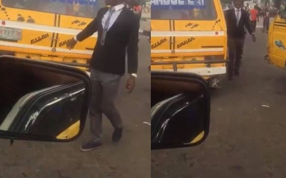 Bus conductor in suit