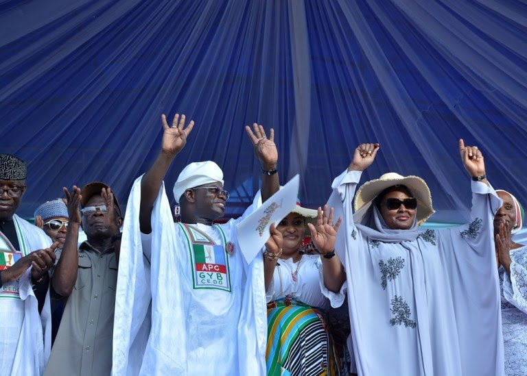 APC members showing off four+four sign