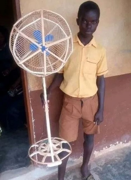 Teenage pupil who built a standing fan with wood