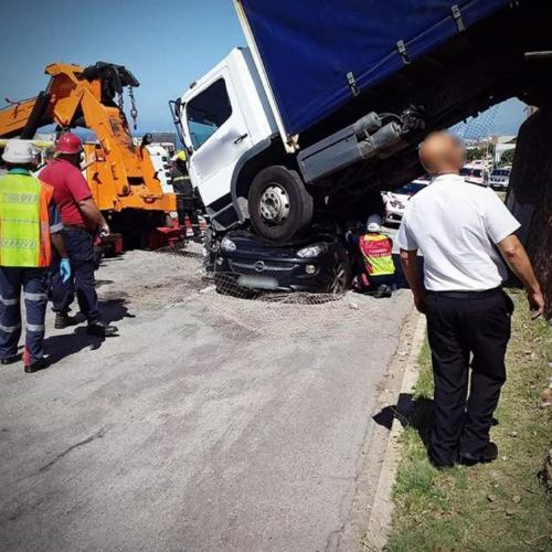 Woman survives with injuries after heavy lorry landed on her car