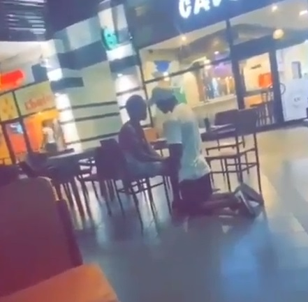 The man kneeling to beg his girlfriend