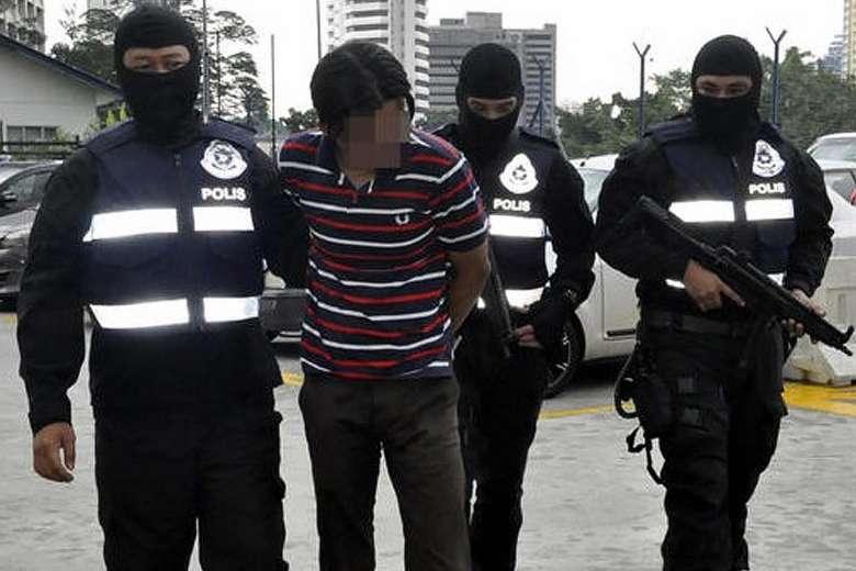 File photo: Police arresting a suspect