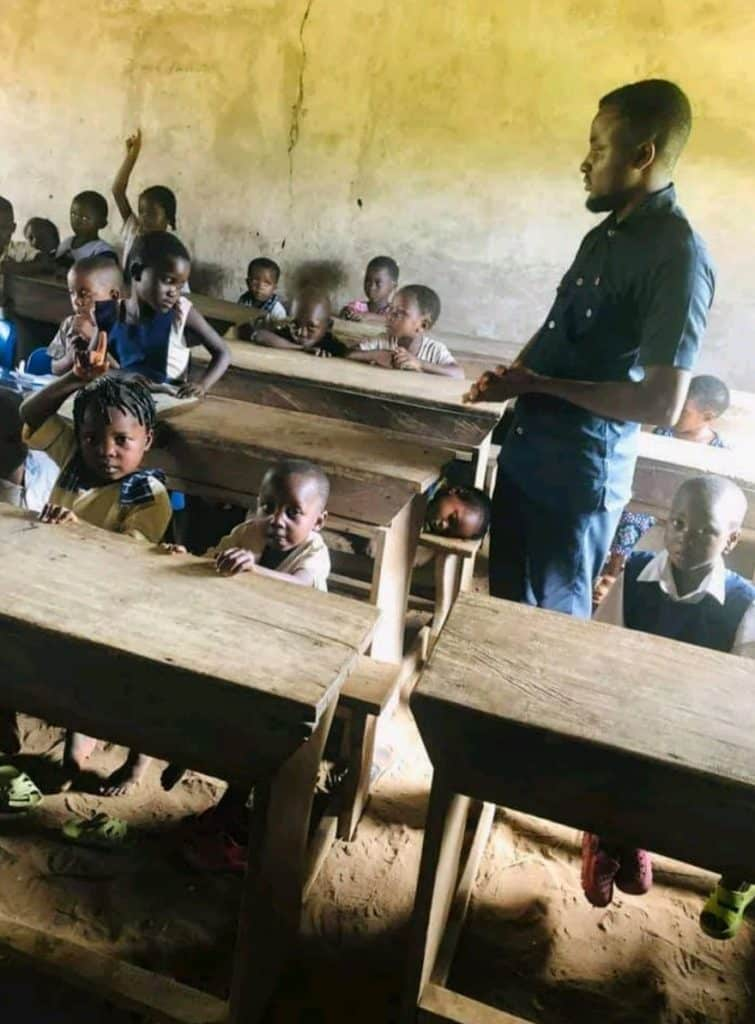 Primary school where students learn under thatch hut