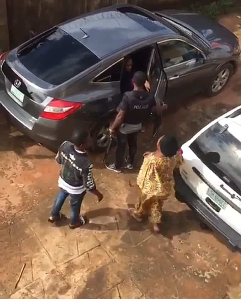 Nursing mother being arrested by the police